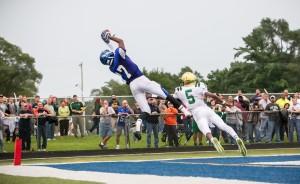 Oakridges James Cooper skies for the ball against the defense of MCC #5 Christian Martinez photo/Tim Reilly