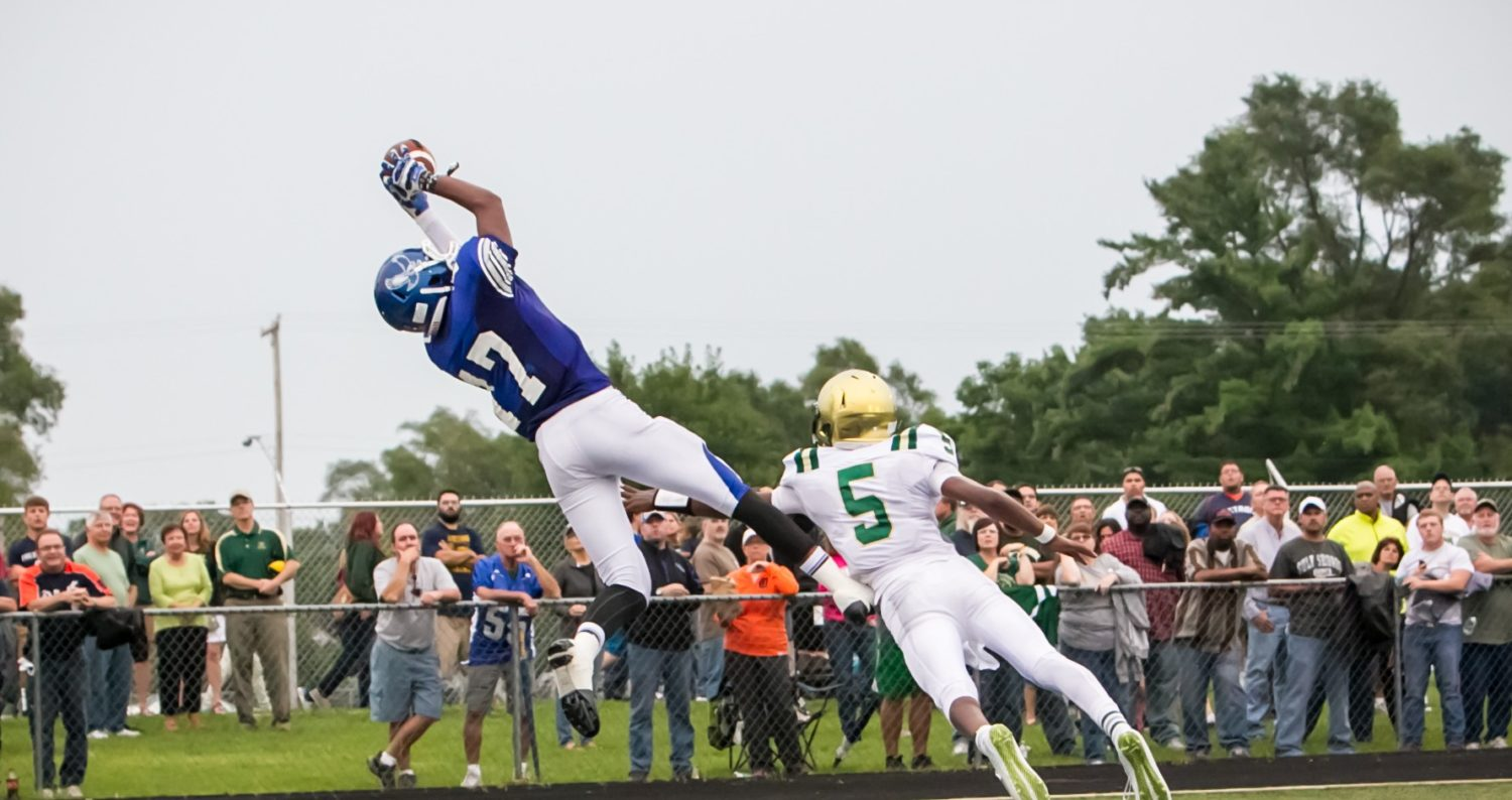 Luttrull throws six TDs to Cooper, propelling Oakridge to a stunning 45-26 drubbing of Muskegon Catholic
