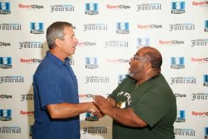 Legendary MCC head coach Mike Holmes shakes hands with LSJ photographer Joe Lane. Photo/Marc Hoeksema