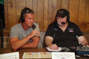 Steve Cezerwon talks with WLCS 98.3 FM's Power Hour host John Russel during the high school football preview release party. Photo/Marc Hoeksema