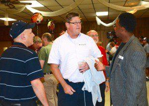 Former Michigan football player Mike Reinhold talks with John Karafa and Brian Burrell at Tatra Hall. Photo/Marc Hoeksema.