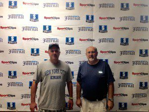 Get your photo taken with a local high school football coach, with LSJ's banner for a backdrop.