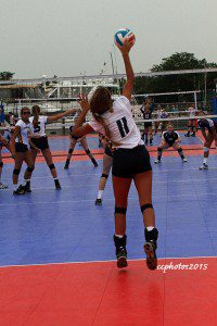 Libby Cole on the serve for Grand Haven. Photo/Carol Cooper