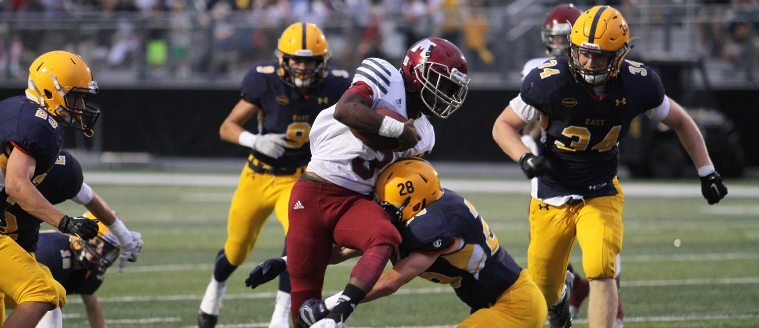 Pimpleton, Copeland lead Big Reds to a convincing 56-28 victory over previously unbeaten East Grand Rapids