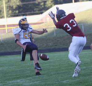 Orchard View's No. 33 Cameron Williams comes up with the blocked punt. Photo/Scott Stone