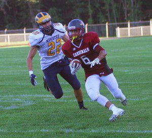Devin Pascavage rushes the ball up field while being pursued by Manistee's Carter  Eckhardt. Photo/Scott Stone