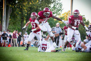 Terrion HIll-McKay jumps Grandville's No. 21 Jalen Raniga. Photo/Tim Reilly