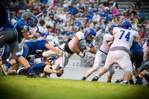 David Thompson dives over the goal line for the first half Ravenna score. photo/Tim Reilly