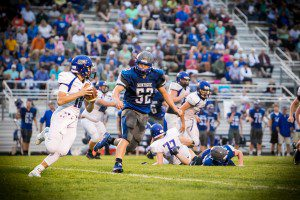 Montague #52 chases down Ravenna QB #10 Nick Castenholz photo/Tim Reilly