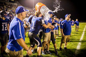 Montague Head coach Pat Collins gets a well deserved shower to celebrate his 100th win. photo/Tim Reilly