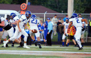 Nick Castenholtz hands off to David Thompson, with No. 23 Seth Morgan leads the way for Ravenna. Photo/Sherry Wahr