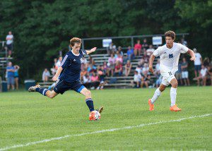 Fruitport's Noah Hendrix blasts a shot from 20 yards out. Photo/Eric Sturr