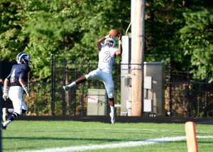 Mona Shores' Deandre Oaks-Owens (2) leaps high for their second TD of the first quarter. Photo/Eric Sturr