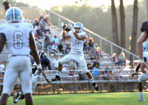 Elijah Wilson (13) grabs the second Mona Shores interception of the game. Photo/Eric Sturr