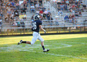 Connor Schuitema runs a Mona Shores kick-off back for Fruitport's first TD. Photo/Eric Sturr