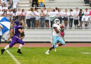 Darece Roberson catches a bomb in stride from Tyler Trovinger for a Mona Shores TD. Photo/Eric Sturr