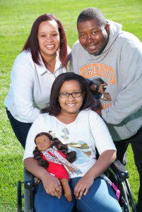 Muskegon Heights football coach Tommie Elliott (top right), his wife Roslyn and his daughter Torrie (front). Photo/ Marc Hoeksema.