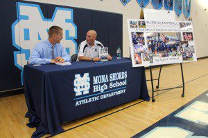 Mona Shores AD Ryan Portenga, left, talks with football coach Matt Koziak at a Tuesday press conference. Photo/Jason Goorman