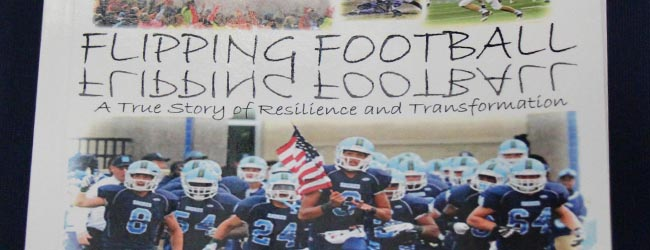 Mona Shores AD publishes a book about the dramatic revival of the Sailor football program