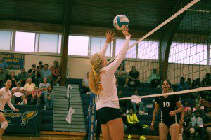 Hannah Landstrom does a quick set over the net for North Muskegon. Photo/Hailey Liverance