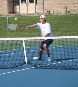 No. 1 singles city champion Nick Schanhals at the net for North Muskegon. Photo/Jason Goorman