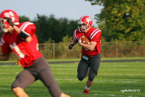 Reese Carlen rushes the ball in the backfield for Spring Lake. Photo/Carol Cooper