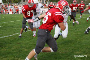 Drew Cather rushes up the sideline for the Lakers. Photo/Carol Cooper