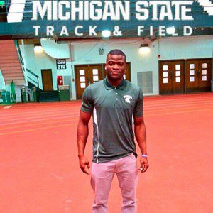 John Waller stands inside the track and field practice facility at Michigan State.