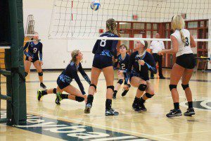 Mona Shores' Madison gets the dig. Photo/Jason Goorman