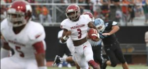 Kalil Pimpleton rushes the ball for Muskegon. Photo/Doug Simms
