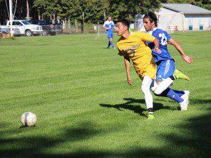 Brandon Edwards moves up field on the Jayhawk attack. photo/Jason Goorman