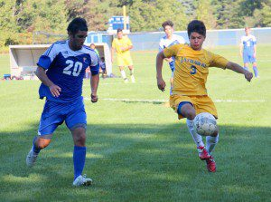 MCC's No. 3 Miguel Flores looks to control the ball during first half action. Photo/Jason Goorman