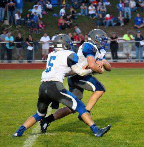 Montague's Zack VanVleet gets the hand off from quarterback Jacob Buchberger. Photo/Jason Goorman