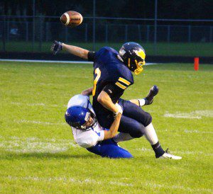 David Thompson strips the ball from North Muskegon's No. 3 Andrew Butzow. Photo/Jason Goorman