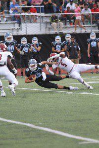 Terrion Hill-McKay makes the tackle on Grand Rapids Christian's Lucas Fotis. Photo/Doug Simms