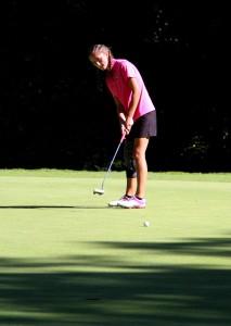 Reeths-Puffer's Korina VanDuinen puts on No. 2 during the GMAA city golf tournament. Photo/Jason Goorman
