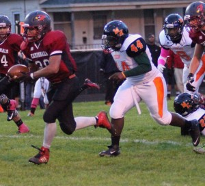 Orchard View's Andrew Puckett breaks free for a rushing TD on the Cardinals opening play. Photo/Scott Stone