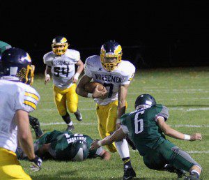 Vernonell Smith rushes up the middle for North Muskegon as Hesperia's No. 6 Gerrit Yates makes the tackle. Photo/Scott Stone