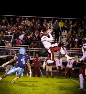 Muskegon's Keyante Carpenter comes down with the interception. Photo/Tim Reilly