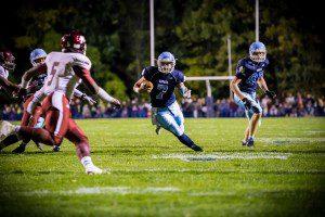 Mona Shores quarterback Tyler Trovinger on the rush around the side. Photo/Tim Reilly