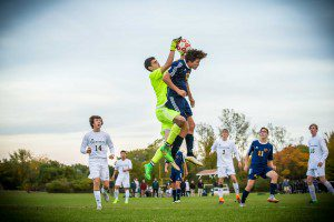 MCC goalie Connor O'Neill skies for the ball photo/Tim Reilly