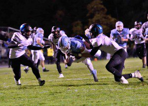 Mona Shores' Tyler Trovinger dives for the end zone for Mona Shores' first touchdown. Photo/Eric Sturr