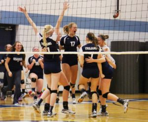 Fruitport celebrates after scoring the match point to secure the city volleyball title. Photo/Jason Goorman