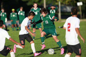 Noah Sorn (10) jukes around Union's defense. Reeths-Puffer defeats Grand Rapids Union by a margin of 2-1 Oct. 1 at Grand Rapids Union High School.