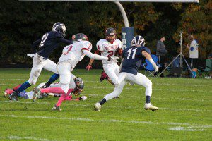 Orchad View's Dakota Goosen rushes the ball while Dev'ron Williams looks to block  as Fruitport's No. 11 Matt Sander and No. 12 Zack Miller pursue. Photo/Stacey Flores
