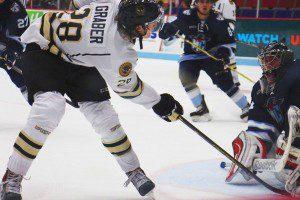 Will Graber tries to sneak a shot past Madison goaltender Ryan Edquist. Photo/Jason Goorman