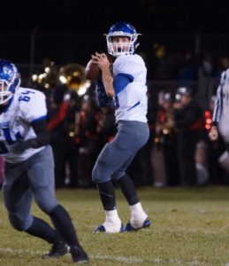 Brady Luttrull drops back to pass for Oakridge. Photo/Sherry Wahr