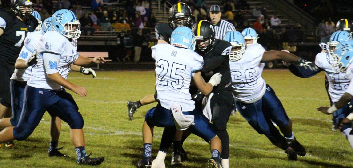 Mona Shores completes its first 9-0 regular season, nails down O-K Black title, with a 42-20 win over Kenowa Hills