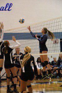 No. 11 Madison Dunn tries to sneak in a point for Mona Shores. Photo/Jason Goorman