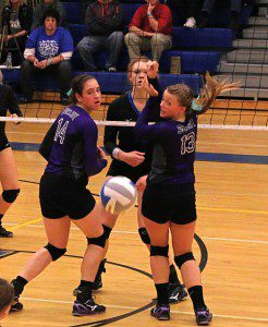 Montague's Emma Flagstead watches her spike find the court as Shelby netminders No. 14 Brooke James and No. 13 Sarajane Fortier look back for a Tiger dig. Photo/Steve Markel